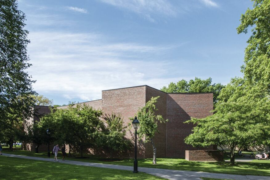 Burden Hall, an auditorium designed by Philip Johnson in 1968, was the first building to depart from the original campus's Georgian Revival style.