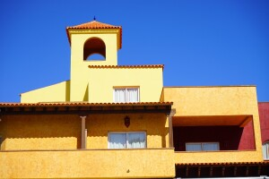 A Mediterranean-style building. This architecture style has not appreciated in price in the same way as other styles.