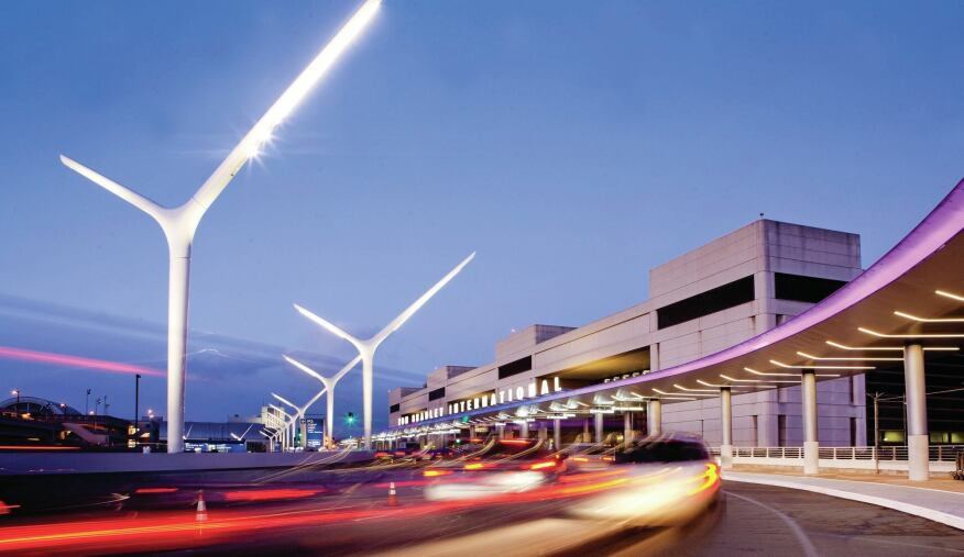 The approach to Tom Bradley International Terminal with the new lighting improvements, which feature a series of sculptural roadway light poles and a new, illuminated entrance canopy.