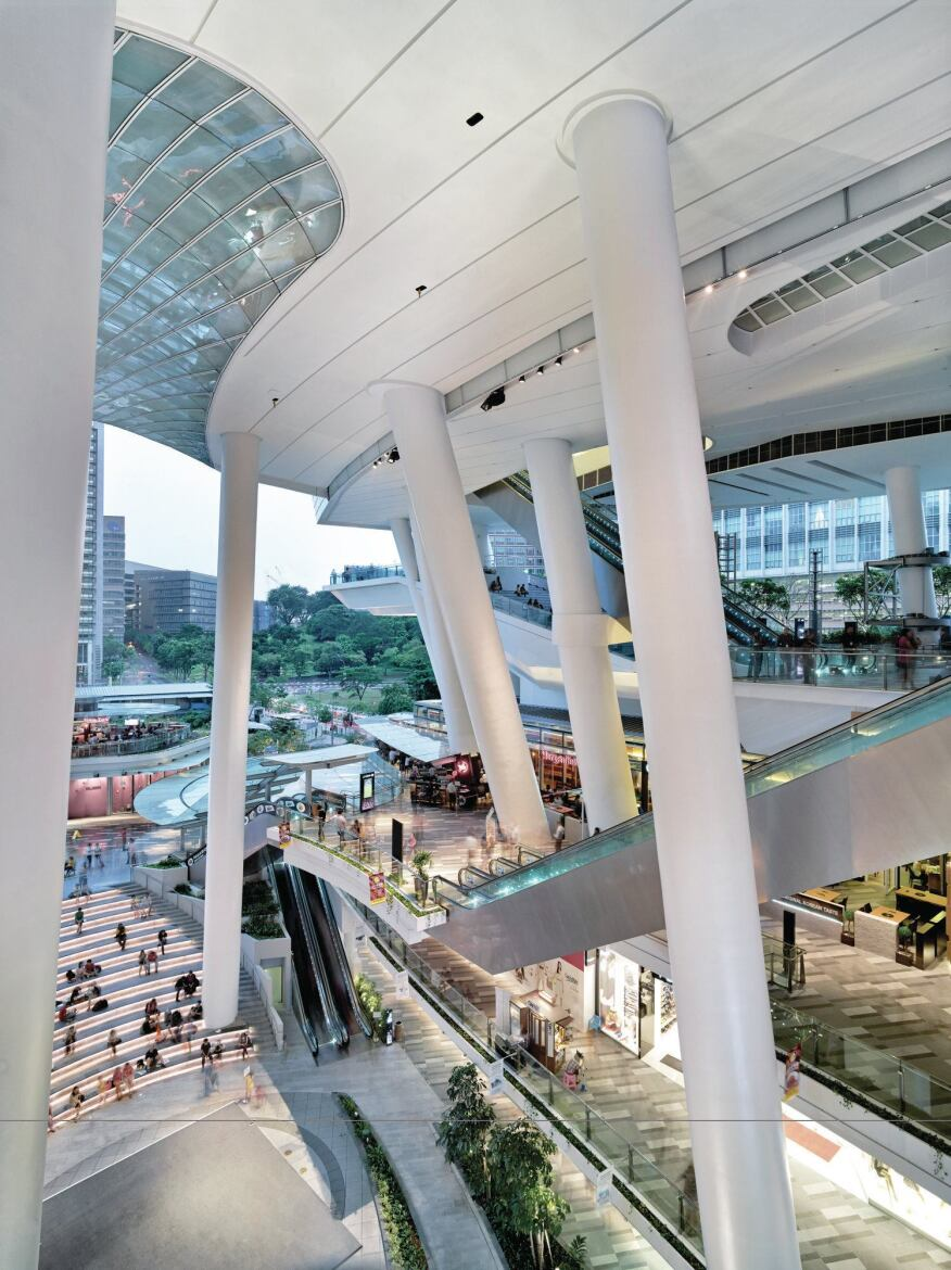The curved glass surface also serves as the ceiling of the open air mall, which features escalators that lead to the civic   levels above.