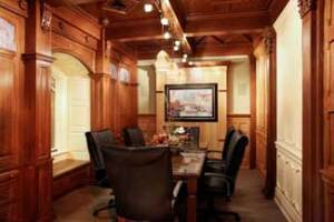 A conference room within the showroom helps customers visualize the dealer's custom panels, ceiling elements, and furniture in a home.
