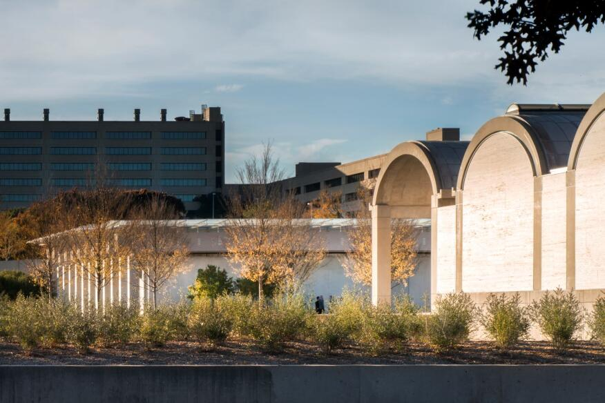 View of the southern façades of Louis Kahn's 1972 original Kimbell Art Museum building, and the Renzo Piano Pavilion across the garden.