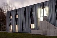 Hertl.Architekten Covers Building in Curtains