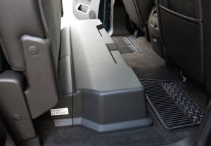 The battery for the GMC Sierra hybrid pickup truck is stored under the rear seat.