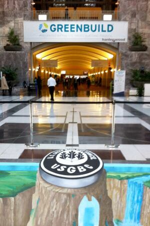 Artist Tracy Lee Stum puts the finishing touches on her 3-D art installation commemorating the USGBC's 20-year history.