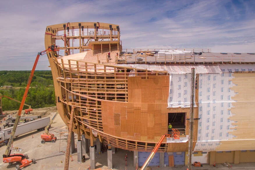 The replica structure comprises a series of timber cross frames, spaced 18 feet on center, that include two 18-inch-deep glulam ribs, which form the building's curved hull.