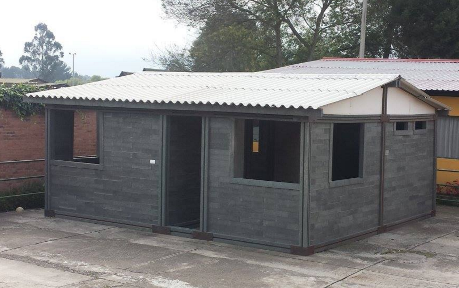Lego houses made from waste plastic house the homeless for Waste material used in home