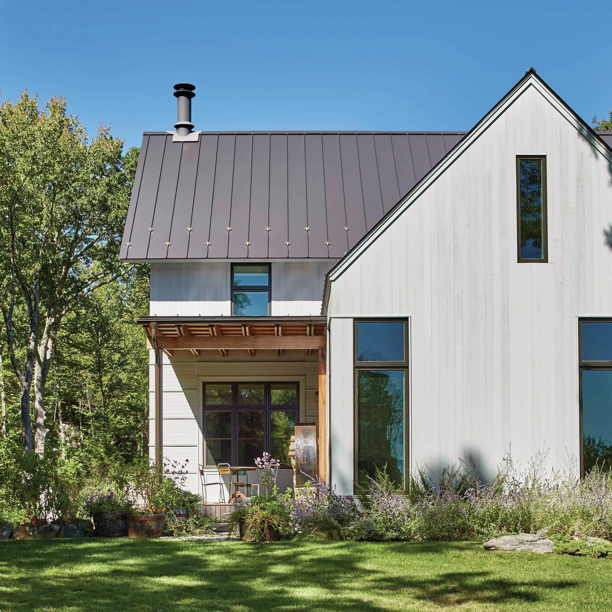 Modern farmhouse architect magazine albert righter for Custom home designs online