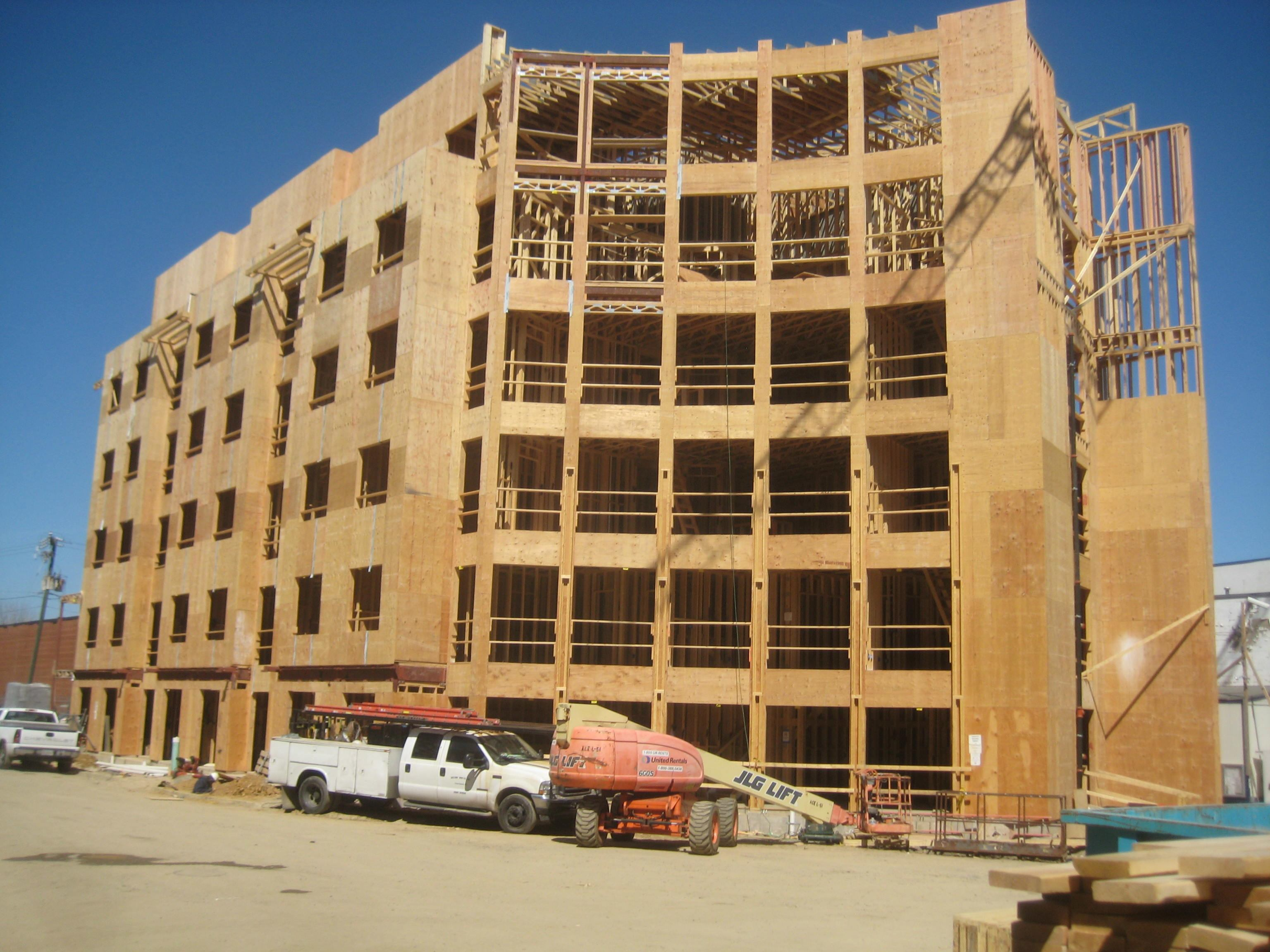 Multifamily developers turn to wood frame construction to for A frame house cost