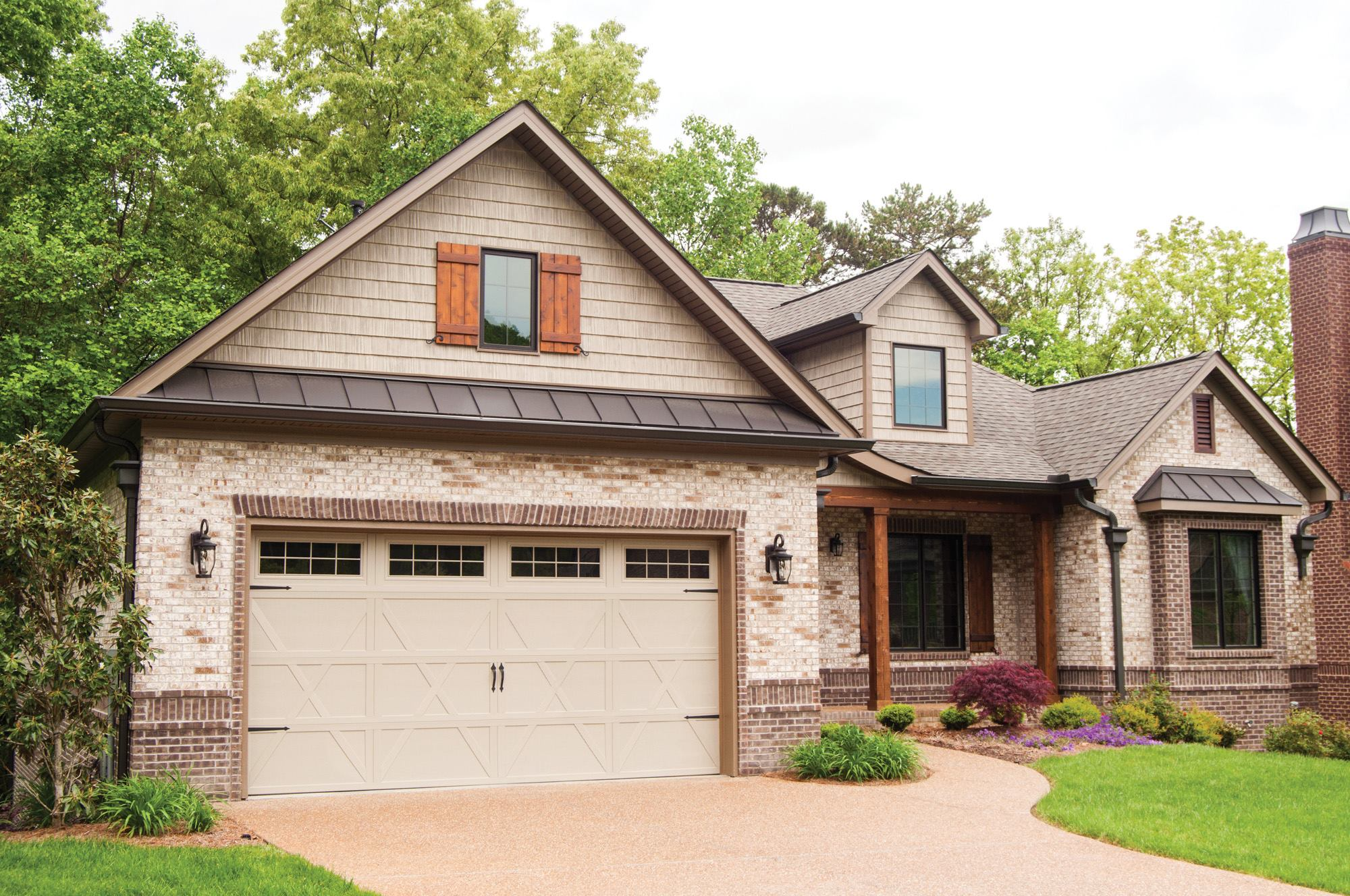 Carriage House Style Garage Door Brings Old World Charm