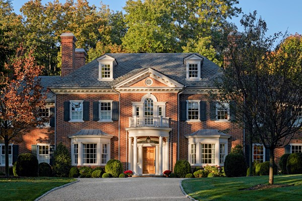Red Brick House With Navy Shutters