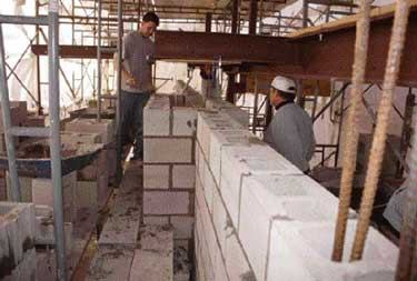 Building a reinforced concrete block wall jlc online for How to build a block foundation