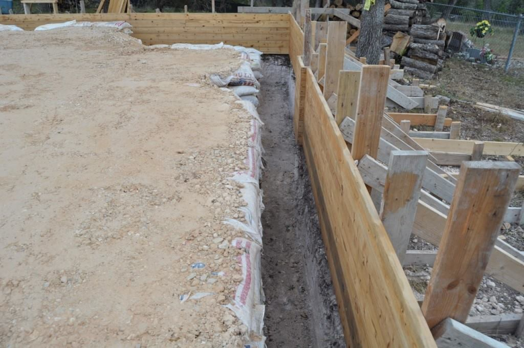 Board formed concrete step by step custom home magazine for Basement wall forms