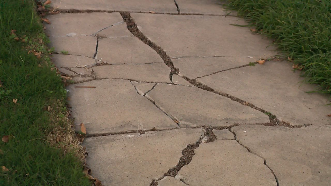 City Looks At New Way To Fix Sidewalks Concrete