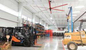 Lift Truck Center's MacroAir fan acts as an efficient cooling solution for the company's warehouse. Their MacroAir fan has a light kit with custom red blades to also stand out as an aesthetically pleasing touch to the space.