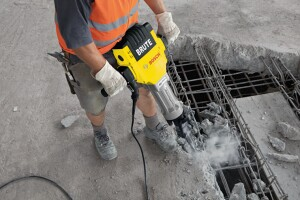 Breaker or demolition hammers are the biggest hammers but are too heavy for vertical surfaces.
