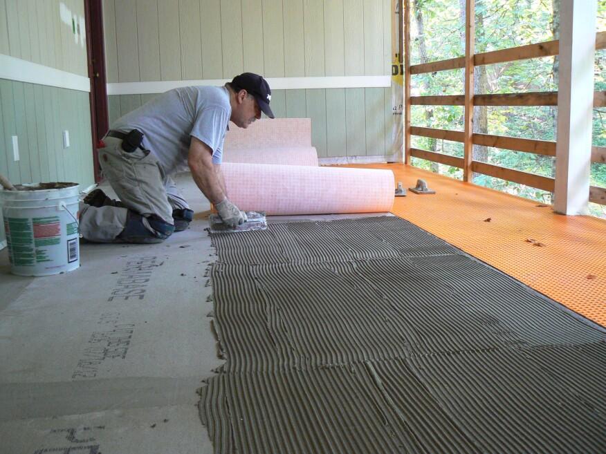 Wood Porch With a Tile Deck | Professional Deck Builder