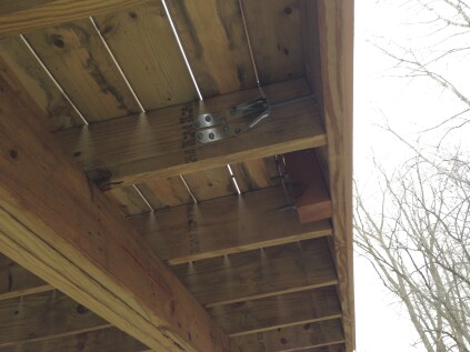Lateral-load brackets are often required to reinforce the connection between cantilevered joists and the rim joist.