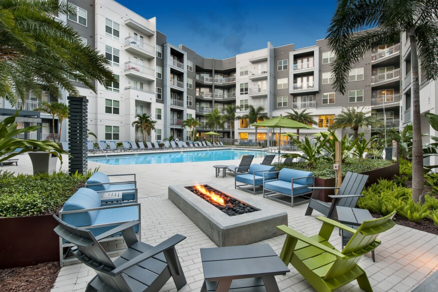 Bleecker at Hyde Park, a Fogelman-managed property in Tampa, Fla., features an outdoor pool courtyard area with a fire pit to foster social interaction and relaxation among residents and their guests.