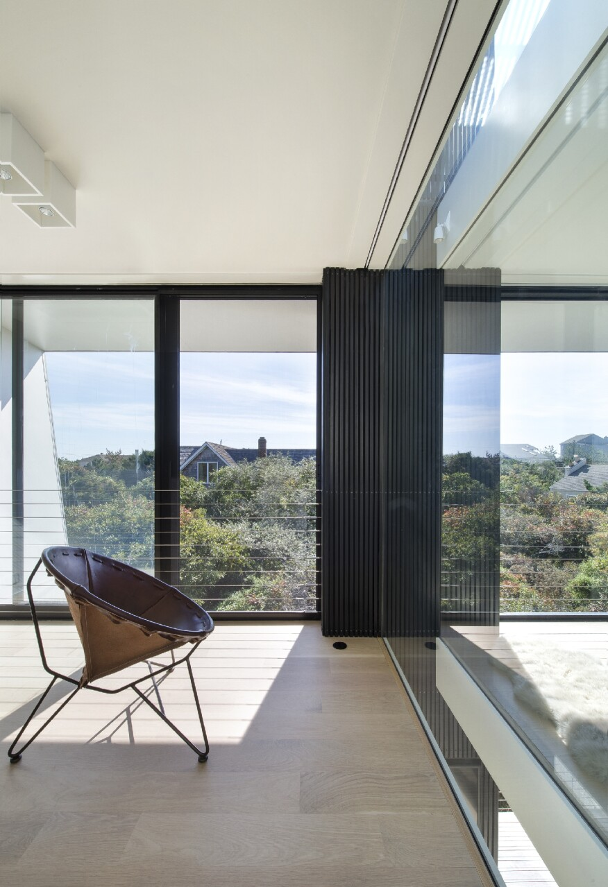 Small and sculptural in the hamptons builder magazine for Beach house construction cost