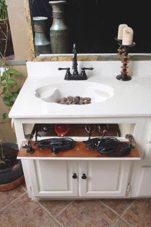 Hair Dryers And Other Styling Products Clutter The Countertop By Utilizing Wasted E Behind Vanity S False Front Panel Valet