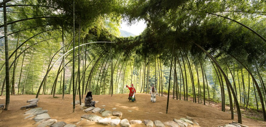 From Cooper Hewitt: Bamboo Theater by Xu Tiantian, founder of the Beijing-based firm DnA_Design and Architecture, is a living structure located in a rural village in China that treats nature like a partner rather than a resource. The open-air theater has walls of living bamboo that villagers bend and weave inward to form a vaulted space.