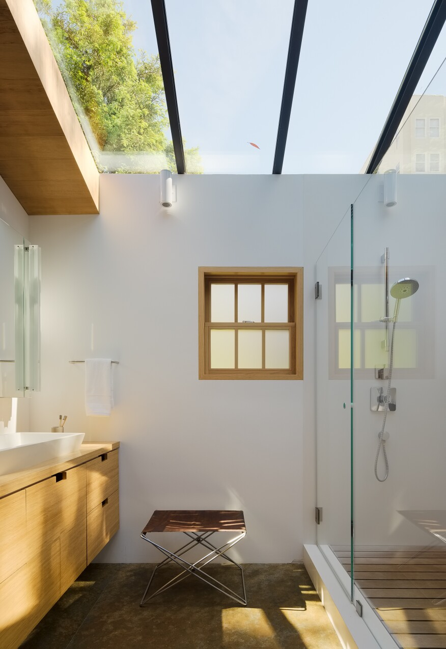 The wet area, shower, sink, and skylight in the Cow Hollow Residence's master bath.
