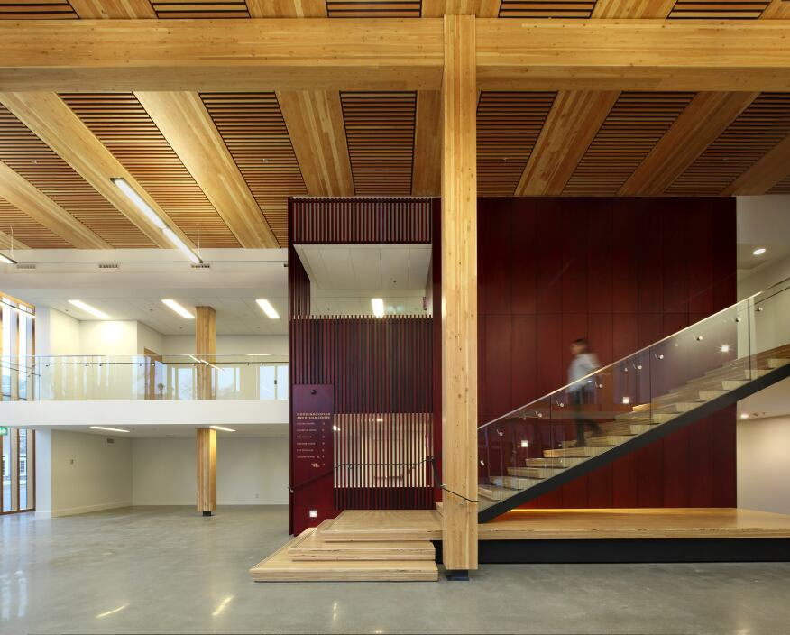the eight story tall building has a timber post and beam structure - Innovative Wood Beam Ceiling