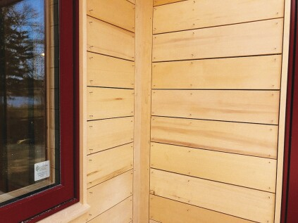 In an open rainscreen, the siding nails to the furring strips with air gaps between the boards.