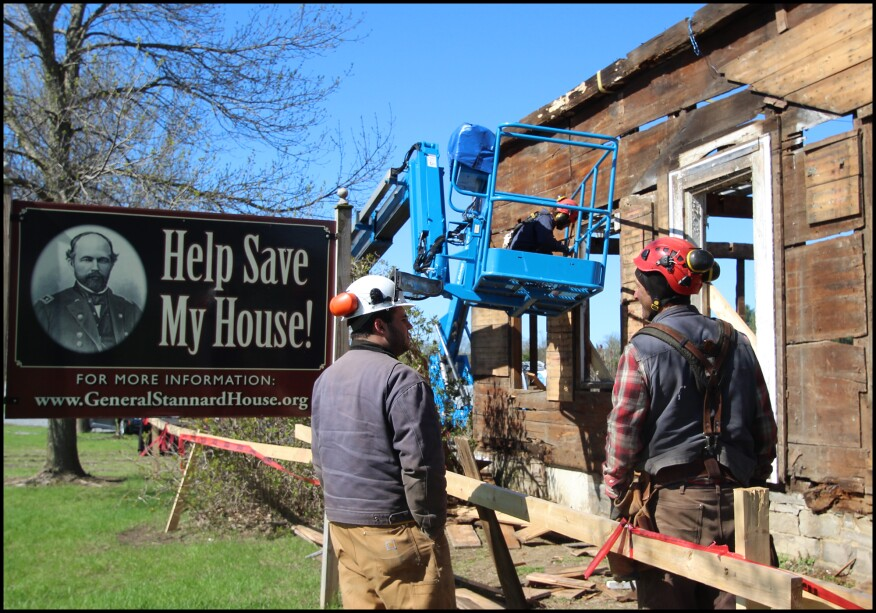 "The author's company, Building Heritage, was tasked with documenting, carefully dismantling, and storing the historic farmhouse for a later restoration on a new site. The restored General Stannard House is to serve as a key location on the newly-formed ""Vermont in the Civil War Heritage Trail"". Here, author Eliot Lothrop (right) talks with project volunteer, Alex Fenton, (left) on site. Dan Lee of Building Heritage begins removing the home's wide board sheathing from a personnel lift."