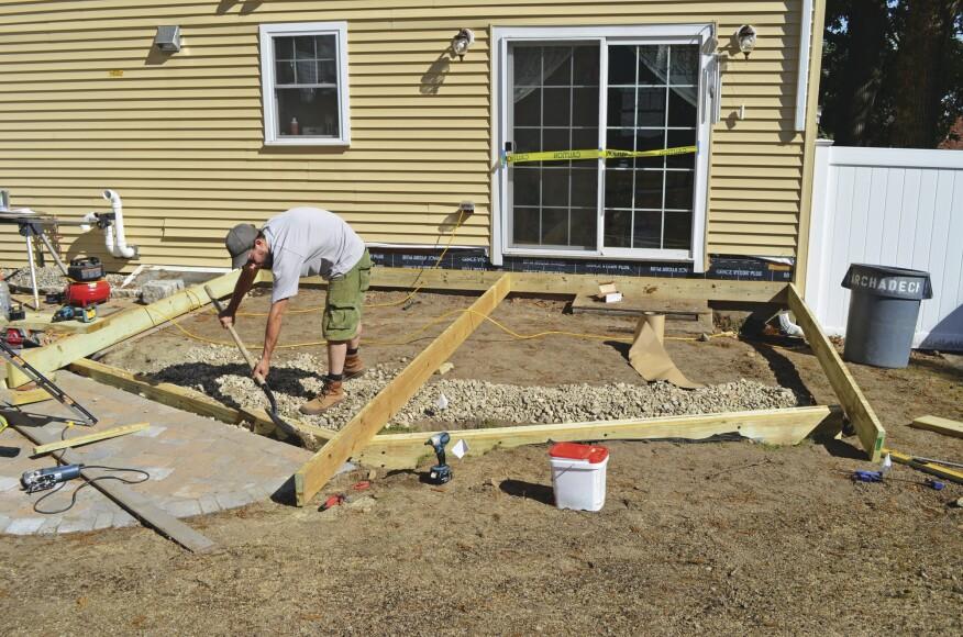 Building a deck on grade professional deck builder for Steps to start building a house