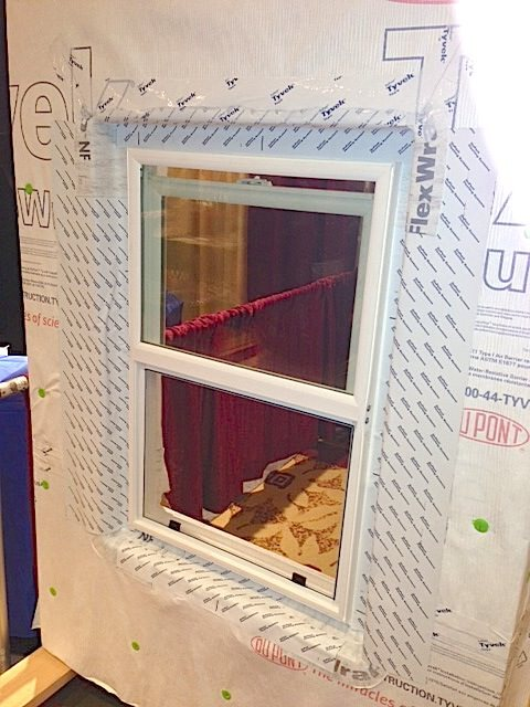 Here, the window has been applied directly to the wall before the application of foam, and then housewrap and flashing are applied.