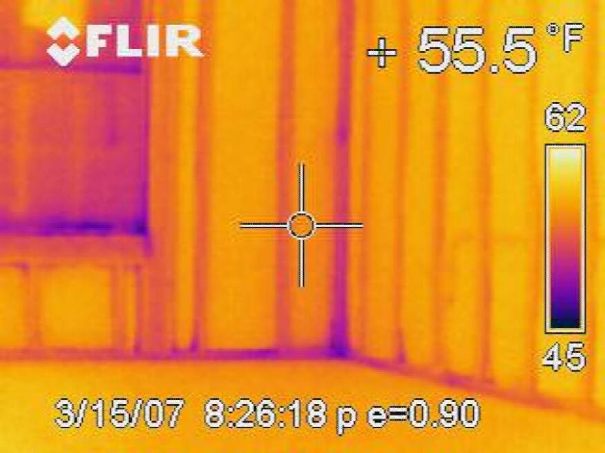 This infrared image shows the cold studs in a heated house on a winter day. Exterior foam insulation could prevent this source of heat loss.