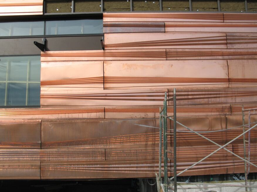 Pillowed Metal Building Wall Panel : Copper keeps a phoenix medical building as cool rock