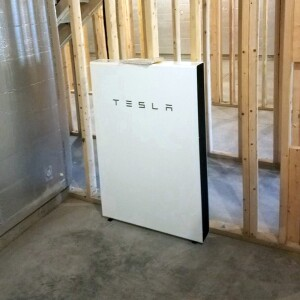 The Tesla Powerwall is a rechargeable lithium ion battery that works in conjunction with solar panels to store excess energy.