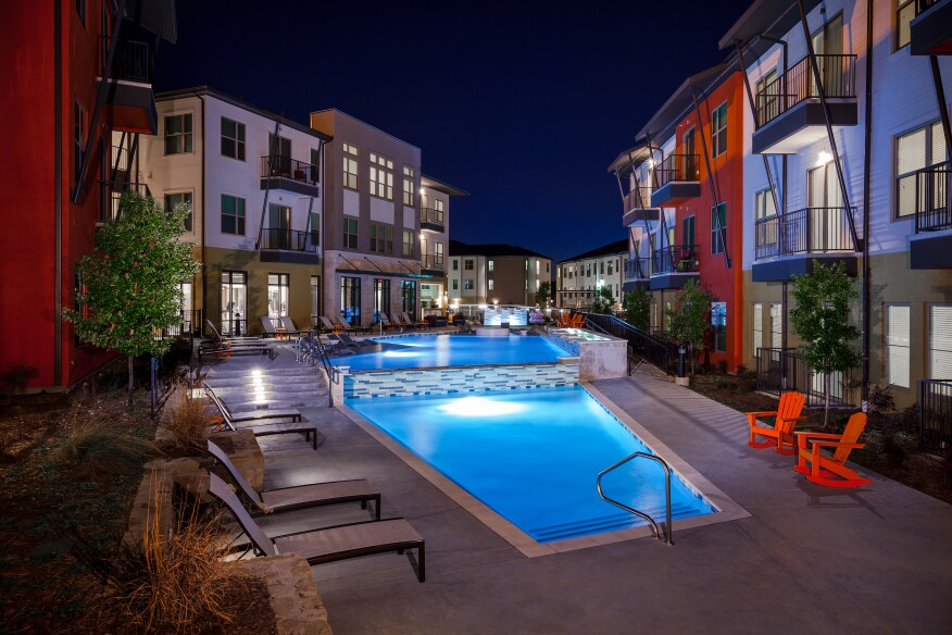 Modular construction doesn't have to equal a lack of high-end amenities. LBJ Station in Dallas offers residents a resort-style pool featuring several in-pool seating areas for lounging that lends a luxury feel.
