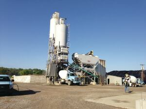 Ready-mixed concrete is discharged into a truck at a Wells Group plant. The producer is based in West Liberty, Ky.