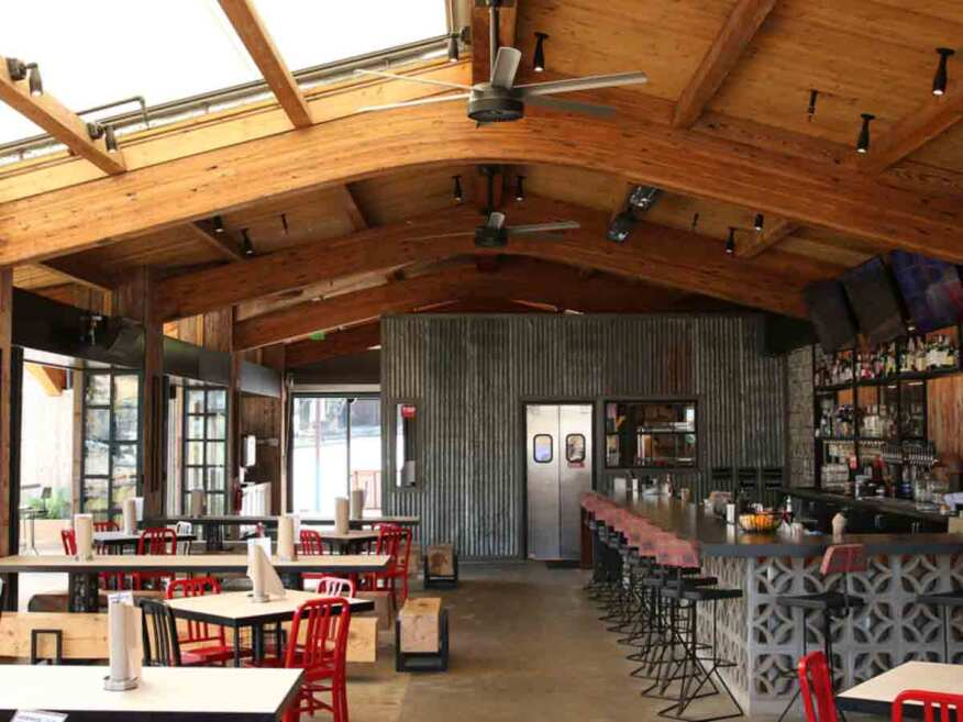 The Crack Shack restaurant in Encinitas, CA uses their MacroAir fans to help circulate the nearby cool coastal air within the restaurant via their open air concept design.