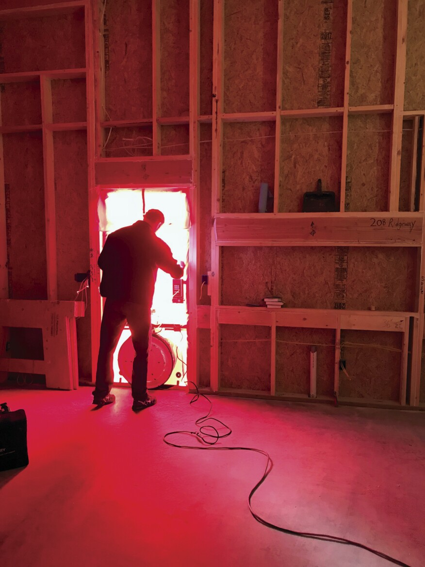 Blower-door testing before insulation allows the crew to easily identify leaks in the shell before they get buried.