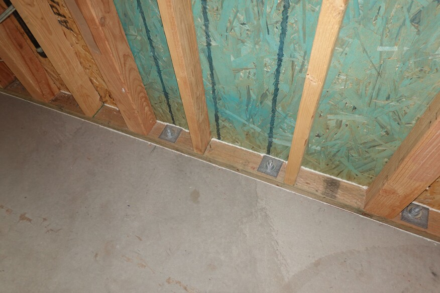Good air-sealing becomes critical when walls are vapor-closed to the outside. Here, a builder did it right, as they have caulked the sheathing joint to the wall plate and the plate to the floor. (Yes, you need to do both.)