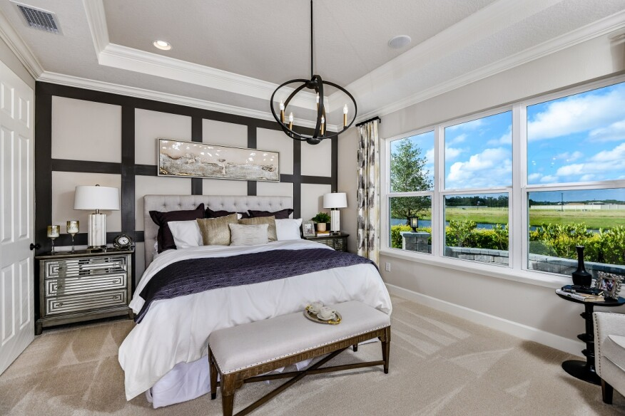 Homes in Taylor Morrison's Eave's Bend, in the master plan of Artisan Lakes in Palmetto, Florida, include luxurious owner's suites as well as flex space upgrades.