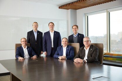 Lansing is truly a family business, with brothers Chase (seated, far left); Hunter (standing, middle); and Ted (standing, far right) all working at the corporate headquarters.