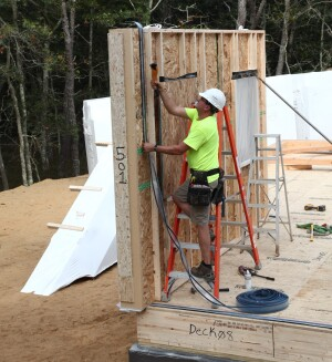 """The homebuilding industry is not waiting around for the next generation of carpenters to come up to speed. Many companies are looking to """"off-site solutions"""" - a.k.a. modular and panelized systems - as a way to reduce labor and increase productivity. Some companies, such as Entekra and Unity Homes (shown here) produce off-site framing systems that rival in performance any stick-built home. The only problem: Currently, only 3% of homes built in the U.S. are built using panelized or modular framing methods. We have a very long way to go, and an enormous lift in capital investment, before such technology solutions will make a significant dent in solving the skilled labor shortage. (Photo by Roe Osborn)"""