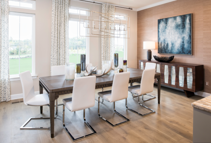 Wood flooring in light shades is especially popular this year, such as in this dining room in Miller & Smith's Brambleton Garden District community in Virginia.