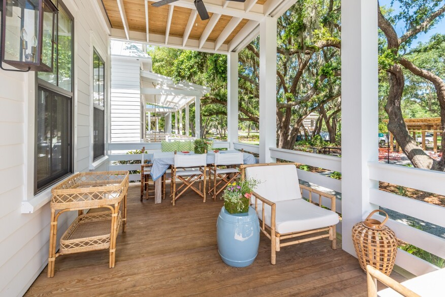 Generous first-level and second-level porches—with optional hanging day beds—allow owners to relax in a shaded outdoor setting.