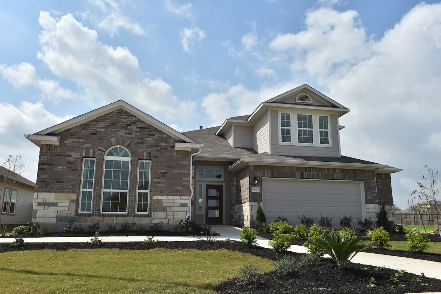 Stone home builders stone home with transitional french for Modern home builder magazine