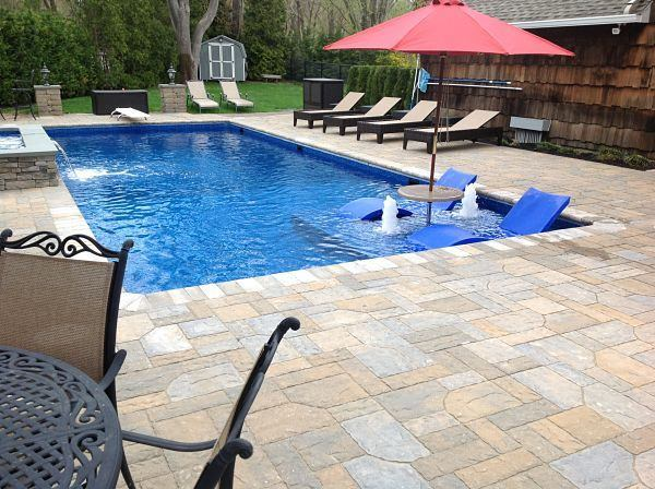 Vinyl as a first resort pool spa news vinyl for Pool design with tanning ledge