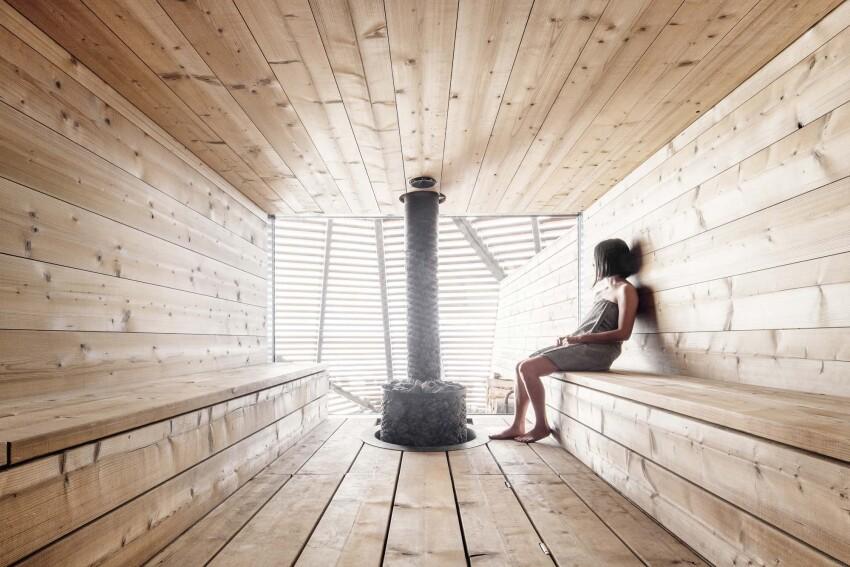Woman in private sauna at Löyly Sauna in Helsinki Finland