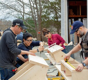 Carpenter Aaron Butt (@aaronthomasaquinas) leads a stair-building workshop at Grand Banks Building Products in Gloucester, Mass.—one example of the new Chautauqua that, with the help of social media, is attracting young carpenters. (Photo: Monica Banks)