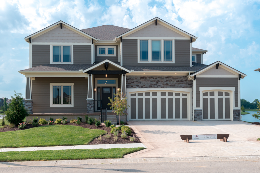 Summit Homes offers designs with three car garages in Kansas City, Mo.